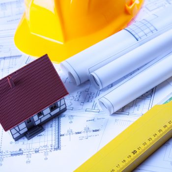Construction plans and tools placed on plans and papers.