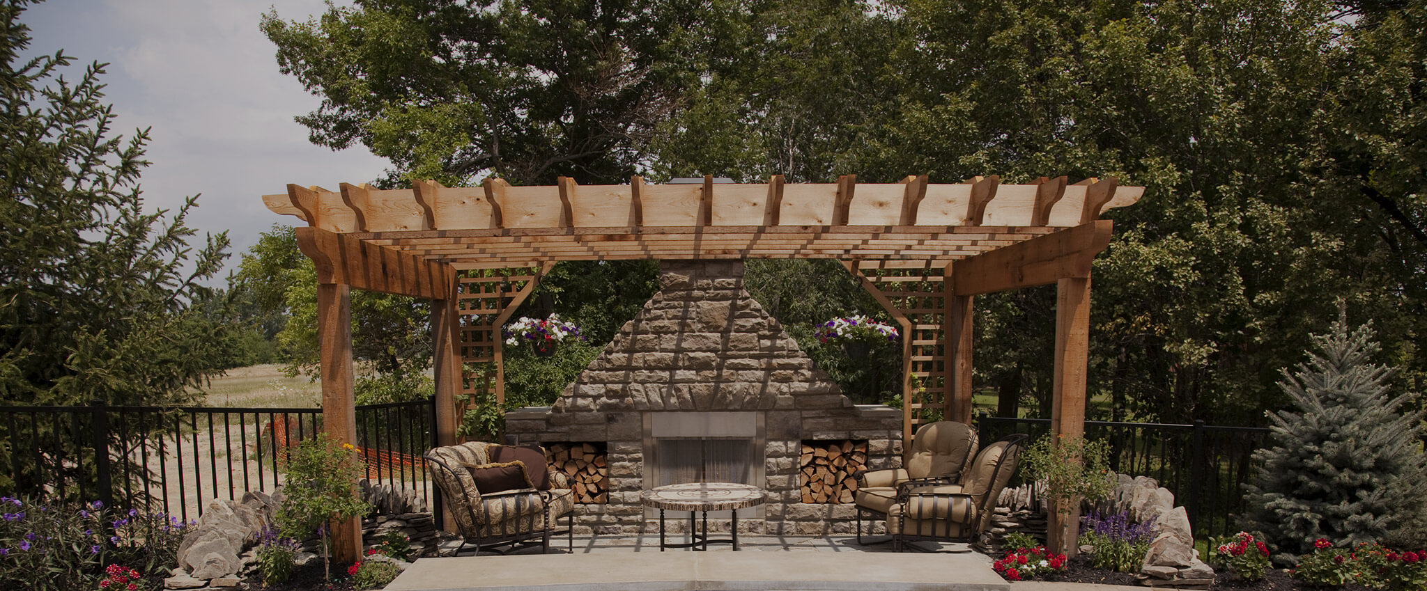 Pergola with outdoor fireplace