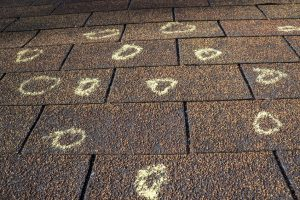 Hail Storm Damage Roof Restoration Marks